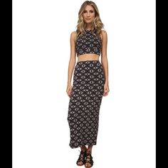 """FREE PEOPLE TEXTURED SET Textured and printed crop top and maxi skirt set in a lightweight easy fabric. Open caged back. Skirt has a slit in back and elastic waist. 97% cotton. 2% elastic. 1% spandex.  Length of top is approximately 15"""". Length of skirt is approximately 38"""". NO TRADES.  Offers made using the """"offer"""" icon under """"buy""""will be considered. Free People Skirts Skirt Sets"""