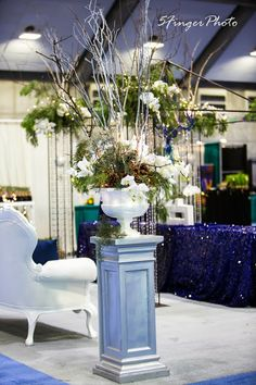 A Blue Ribbon for a Blue Booth! Hilton Worldwide 2013 | Florals & booth design by Visual Impact Design | 5 Finger Photo