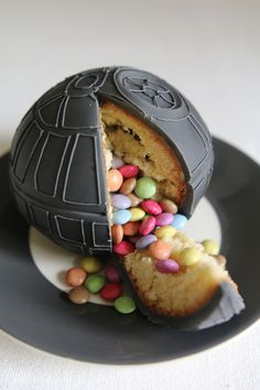 "Death Star Piñata Cake! This would be so much fun to slice and have it ""explode"" with all the colors."