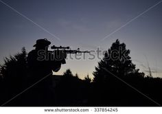 Sniper silhouette forest
