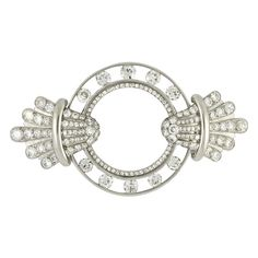 Art Deco Diamond Brooch by Van Cleef & Arpels   From a unique collection of vintage brooches at http://www.1stdibs.com/jewelry/brooches/brooches/