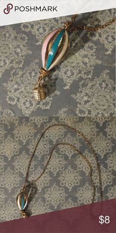 Long Hot Air Balloon Necklace So whimsical and fun! Pastel pink, blue, cream, and bronze. 27 inches long. Jewelry Necklaces