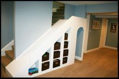 The best FUN basement slide plus storage solution all wrapped into one: cubbies for small toys and a secret tunnel for access to a big toy closet - with a rail on the outside - for sure we'd do this! Kids Basement, Basement Colors, Basement House, Basement Bedrooms, Basement Stairs, Basement Ideas, Basement Bathroom, Finished Basement Playroom, Basement Laundry