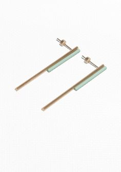 A clean-cut design defines these minimalistic bar earrings, crafted from brass and steel.