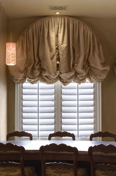 arched calumet balloon shade along with white shutter panels for added light control shade fabric