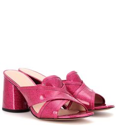 MARC JACOBS - Aurora patent leather mules - Marc Jacob's Aurora mules are all about bringing the fun factor to everyday dressing. Crafted from smooth high-shine patent leather with a glitter look, this fuchsia-pink pair sit on a comfortable block heel and are detailed with crisscross straps that bring a chic finish. Work yours with cropped trousers and a blazer for the perfect day-to-dark look. @ www.mytheresa.com