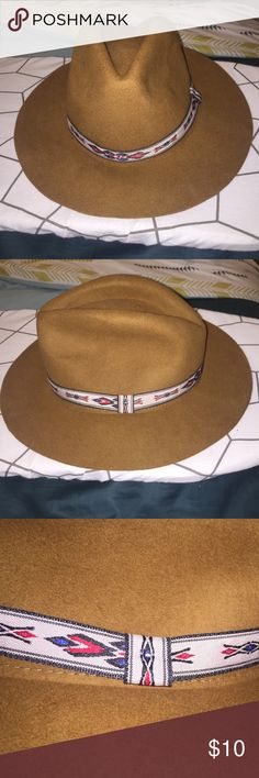Wide Brimmed Fedora Brown wide brimmed fedora | red and brown detailing around hat | one size fits most | I have a big head so if it fits me it should fit you :) Forever 21 Accessories Hats