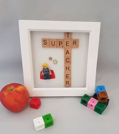 SUPER TEACHER FRAME Treat your childs teacher to this unique gift perfect to keep on their desk in the classroom. Can be made for female and male. Superheros may vary but can be requested on order. AVAILABLE WITH: White or black frame. SIZE: Frame - 6 x 6 Please write in the