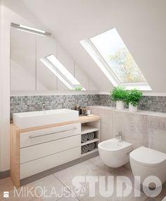 Ładna szafka pod umywalką, szafki lustrzane, bliskie usytułowanie bidetu i szafki pod umywalke