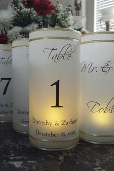 DYI - spray paint cylinders with frosted glass spray paint - use sticky numbers/letters to make own design