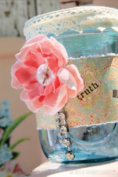 Jazz up your mason jars with flower embellishments, lace, and gems for a vintage feel!