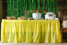 Yellow food table for a John Deere birthday party.