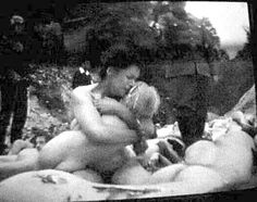 Babi Yar. A naked woman cuddles her terrified naked child as the soldiers round them up to be murdered. Do we have the right to consider ourselves the most evolved species on earth? Sometimes I doubt it.  Horrific crimes perpetrated by human animals on earth