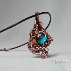 Wire wrapped blue glass cabochon pendant on copper sheet by Artual
