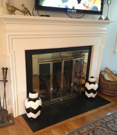 Painted fireplace hearth tile. Remove bricks and put down slate to ...