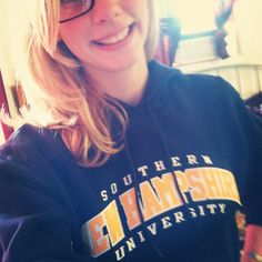 Suzy, an @SNHU On Campus student, shows off her #PenmenPride with her new sweatshirt!