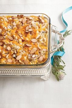 Chicken-and-Wild Rice Casserole | Homemade hospitality. Despite the ease of texting, emailing, and ordering online, Southerners still believe in doing some things the old-fashioned way. Southern etiquette and hospitality will never be taken over by technology, which is why traditions like writing thank you notes, going to church, and bringing casseroles to your neighbors are still around. Whether a new neighbor just moved in, a current neighbor had a death in the family, or an old neighbor…
