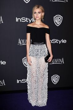 Nicola Peltz In Balenciaga We love the way Nicola paired her gorgeous Balenciaga gown with a slightly messy updo and smoky eye for a cool and sophisticated overall effect.