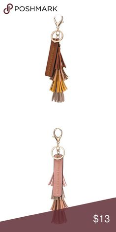 """Tassel Quote Key Ring Melie Bianco Tassel Quote Key Ring by melie Bianco made of premium vegan leather approved by PETA.                                         Chose from.                                                                             PINK: """"ENJOY THE LITTLE THINGS""""                                          or  SADDLE: """"ESCAPE THE ORDINARY""""  Premium Vegan Leather Gold Embossing Dimensions 7 H x 1 W Colors: Blush, Saddle Melie Bianco Accessories Key & Card Holders"""