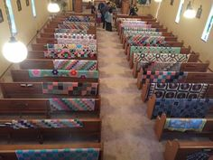 Family lays quilts over church benches to pay a beautiful tribute during service :: the power of femme, love, and healing. This is so powerful and beautiful.