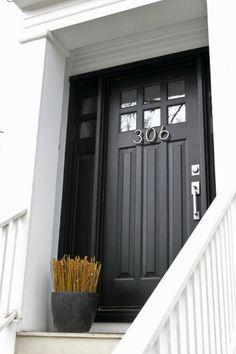 Painting a craftsman door black with these modern house numbers creates a contemporary look for this classic door style.