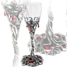 Drinking blood red wine...dinner with Dracula. All appropriate accessories can be found at www.pandorasbox.net.au