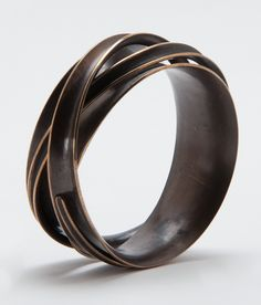 Triple Wrapper Bangle Bracelet by Nancy Linkin. This sculptural bronze bracelet has a rich heat patina. The contrasting edges are polished, which accentuates the wrapped layers of anticlasted bronze. Chunky Jewelry, Copper Jewelry, Modern Jewelry, Sterling Silver Jewelry, Crystal Jewelry, Vintage Jewelry, Silver Bracelets, Bangle Bracelets, Bangles