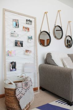 Staple or glue twine to the back of a thrifted frame, then use clothespins to hang up your prints.