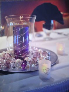 Center piece purple and silver candle with glass beads/marbles or stones.. this is different and pretty too.