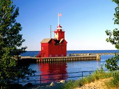 Holland Harbor Lighthouse, known as Big Red, is located in Ottawa County at the entrance of a channel that connects Lake Michigan to Lake Macatawa which gives access to the city of Holland, Michigan. Best Vacation Destinations, Best Vacations, Vacation Trips, Lake Michigan Vacation, Michigan Vacations, Holland Michigan, Le Moulin, Great Lakes, Best Cities