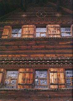 A chalet outside Gstaad built in 1628 and changed very little since. Here we see the arolla pine that makes up the entire exterior and interior, as well as the original windows made from the bottoms of bottles.