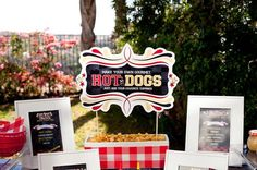 Make Your Own Gourmet Hot Dogs - Just Add Your Favorite Toppings - nice display for this hot dog station.  The frames are recipes for different kinds of hot dogs and how to build them. party-ideas