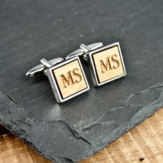 This unique pair of personalised cufflinks features an engraving on walnut wood cased in a polished chrome cufflink setting. Can be personalised with up to three initials.