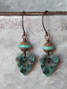 """Beautiful brass patina leaves dangle below Czech glass in a copper teal finish. Perfect for everyday outfits. Measures 1 3/4"""" Brass ear wires #earrings"""