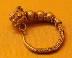 Gold hoop earrings with a goat's head  Ashmolean Museum, Oxford Roman or Ptolemaic late 4-3BC
