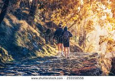 Two men running in forest