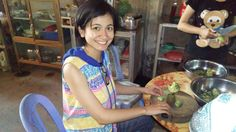 #AIAHannahMei in #AICambodia cutting veggies.