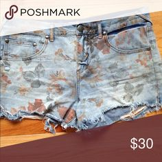 Free People Faded Floral Cut-Off Denim Shorts They run a bit large! I'm a 26-27 and they're a tad loose around my waist. Extremely fun/cute for any outfit Free People Shorts Jean Shorts