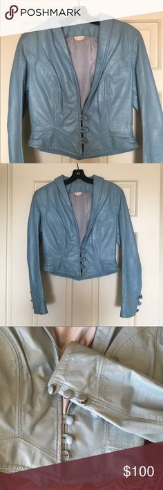 """Rare vintage Trashy Lingerie leather jacket Vintage baby blue leather jacket by Trashy Lingerie in Los Angeles. Tag says Medium but runs more like a Small; note measurements and small waist. Measures 17"""" shoulder to shoulder (same armpit to armpit), bust 14.5"""", waist is 13.75"""" when buttoned, 20"""" long, 22.5"""" sleeve length. Missing 2 buttons (one on front and on one cuff), some wear on right cuff (see 4th photo) and Inner lining has some loose seams that could easily be sewn up. From…"""