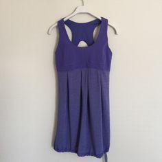 Lululemon purple tank with shelf bra 6 Great condition. Cinching at waist. Adjustable shelf bra. Size 6. Bundle to save 25%! lululemon athletica Tops