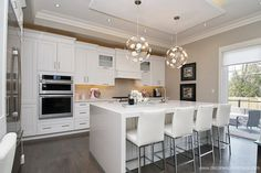 Shaker styled painted door, with a modern crown moulding. Built-in microwave and wall oven cabinet. Waterfall Caesarstone Countertop in Frosty Carrina Transitional Kitchen, Transitional Style, Oven Cabinet, Built In Microwave, Contemporary Kitchens, Shaker Style, Moulding, Wall Oven, Kitchen Styling
