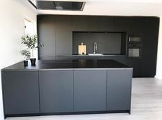 Cooking island in matte black Matte black, industrial kitchen in new-build home with cooking island. The black kitchen is on an oak, PVC herringbone floor. The kitchen is also equi. Modern Farmhouse Kitchens, Farmhouse Kitchen Decor, Black Kitchens, Home Kitchens, Modern Kitchen Design, Interior Design Kitchen, Cuisines Design, Kitchen Styling, New Kitchen