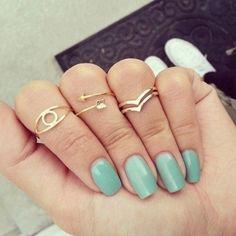 Light blue or teal nails (: