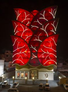 """The shape of the Motisons Jewellers building has been derived from """"lotus"""". The building is square in plan symmetrical from all four sides. Leaves of the lotus flower spring out of the building. Each leaf is created with colored glass in extremely complicated geometry."""