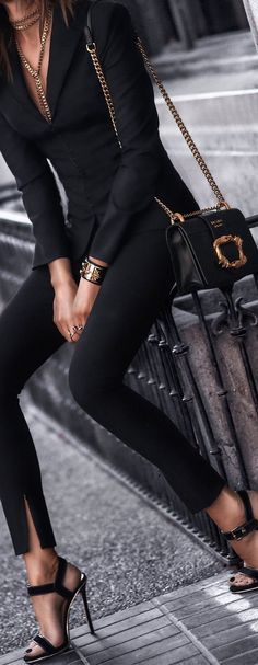 Prada. All black everything with black accessories - great chic work outfit or for when you're going for drinks with your friends!