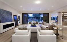 Contemporary formal living room with white furniture and retractable sliding door