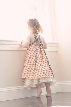 Limited edition sundress in cream and red repro print with vintage crochet detail