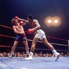 Muhammad Ali lunges for Joe Bugner during their bout in Las Vegas in February 1973. This was the first of two fights in which Bugner went twelve rounds with Ali, both times losing on points.