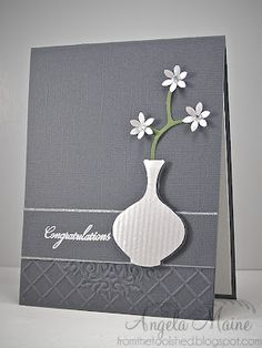 handmade card ... elegant simplicity ... gray and white ... rich textures .... luv the shape and lines on the die cut vase ... great balance in the design ... wonderful card!!!