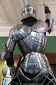 Gothic equestrian armor for rider & horse, South German, circa 1480. Rider's armor composed of original & modern parts; horse's bard is homogeneous with an associated saddle, circa 1510. Detail of rider's backplate, which is original & of high quality and does not correspond to the breastplate.